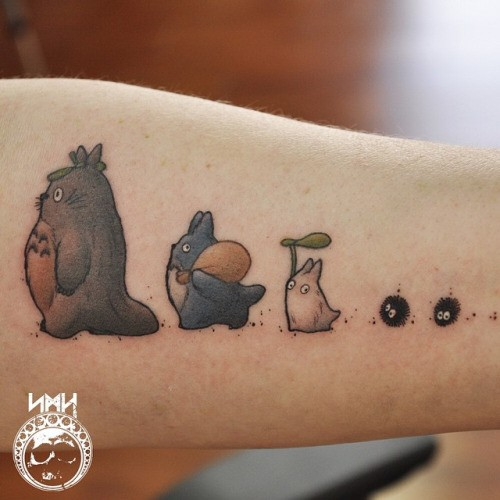 Cute colored little various cartoon heroes tattoo on forearm area