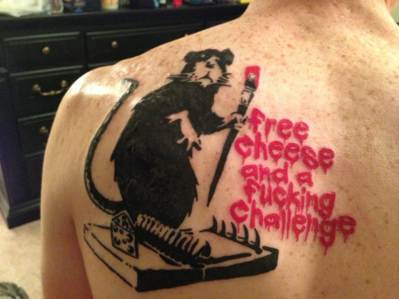 Cute colored mouse with mousetrap tattoo on back combined with red lettering
