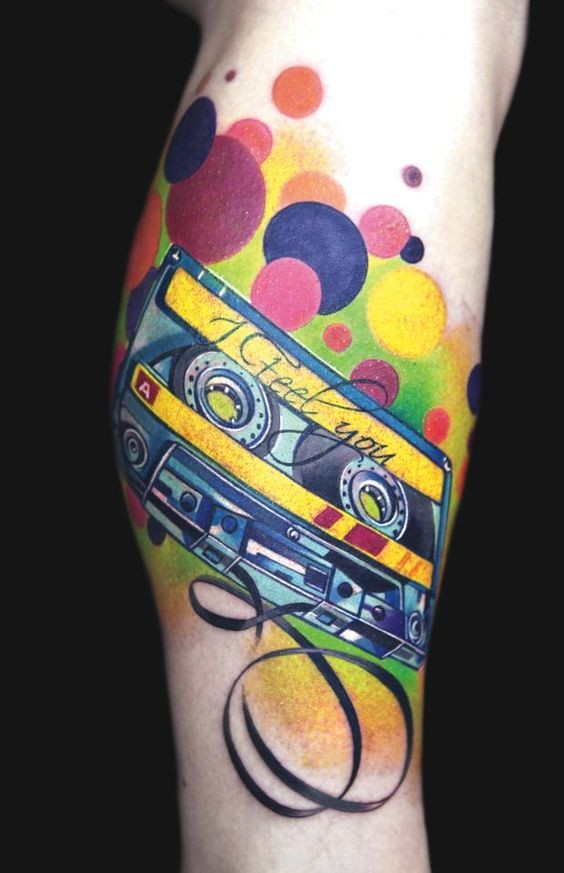 Cute colored old music tape with lettering tattoo on leg