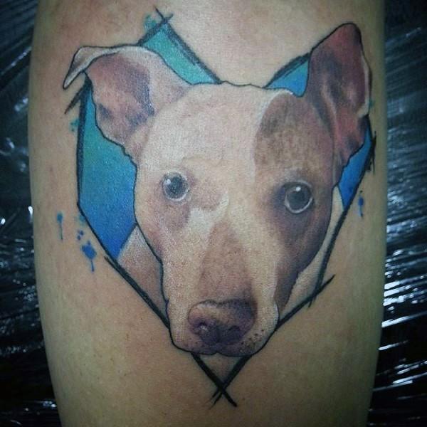 Cute colored realistic dog portrait tattoo on leg