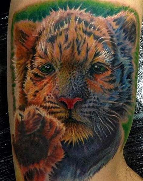 Cute colorful little tiger tattoo