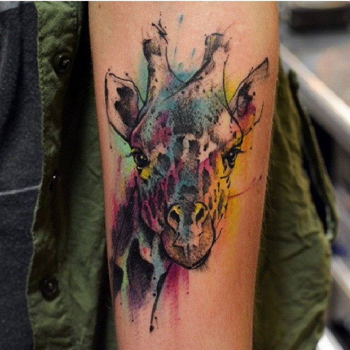 Cute colorful painted giraffe tattoo