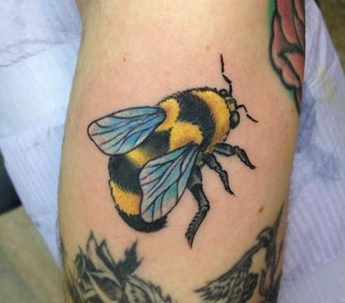 Cute coloured bee tattoo