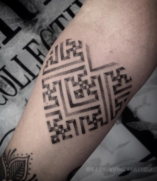 Cute dot style tattoo of big heart stylized with labyrinth