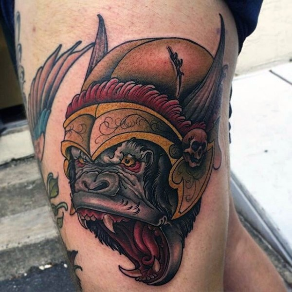 Cute fantasy style colored roaring monkey tattoo on thigh with funny helmet