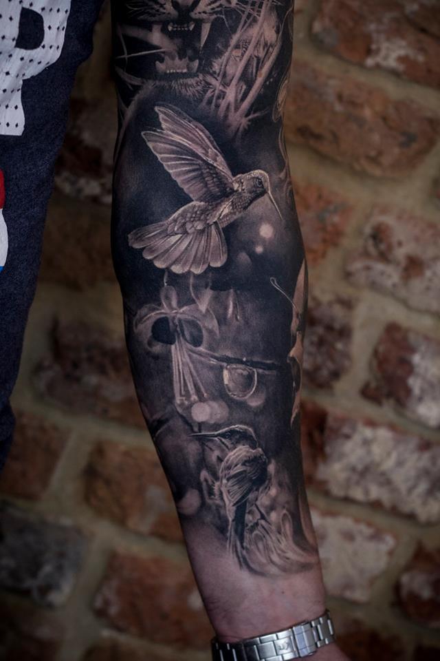 Cute hummingbirds tattoo on forearm