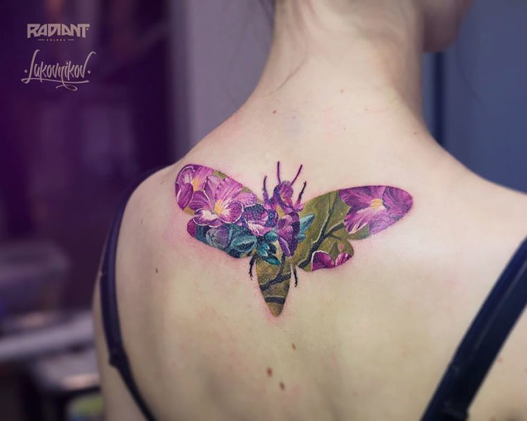 Cute illustrative style back tattoo of bee stylized with flowers