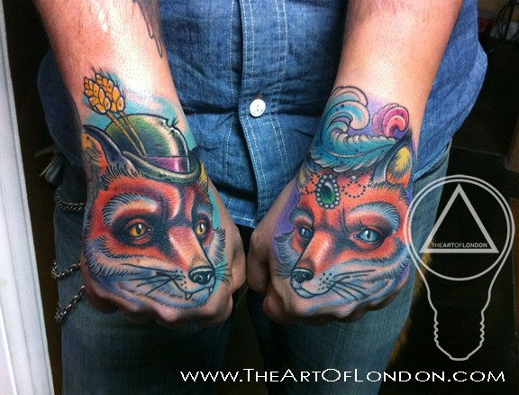 Cute illustrative style colored arms tattoo of foxes couple