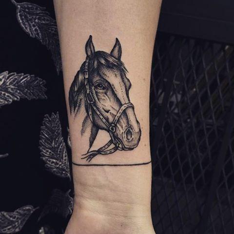 Cute illustrative style forearm tattoo of horse head