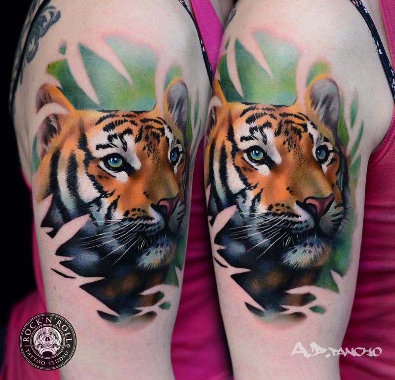 Cute illustrative style shoulder tattoo of tiger head