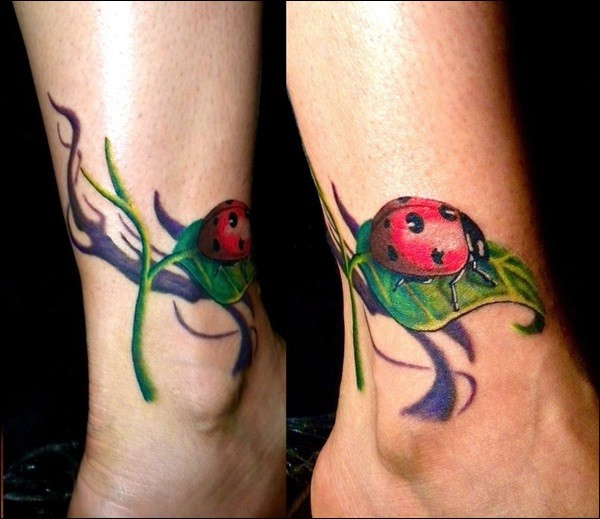 Cute ladybug on green leaf of grass tattoo on ankle