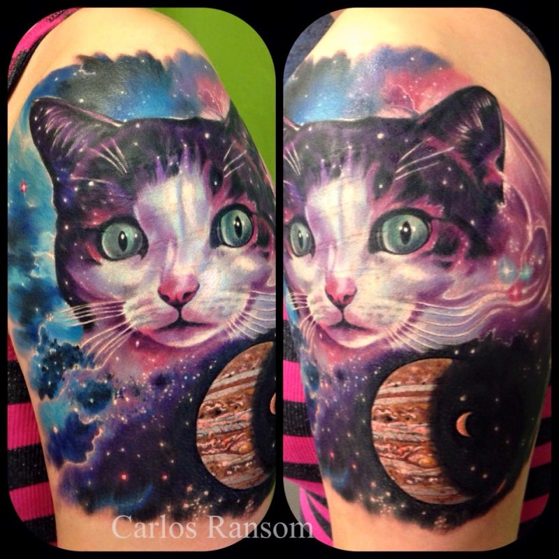 Cute lifelike colored shoulder tattoo of cat stylized with spade and planets