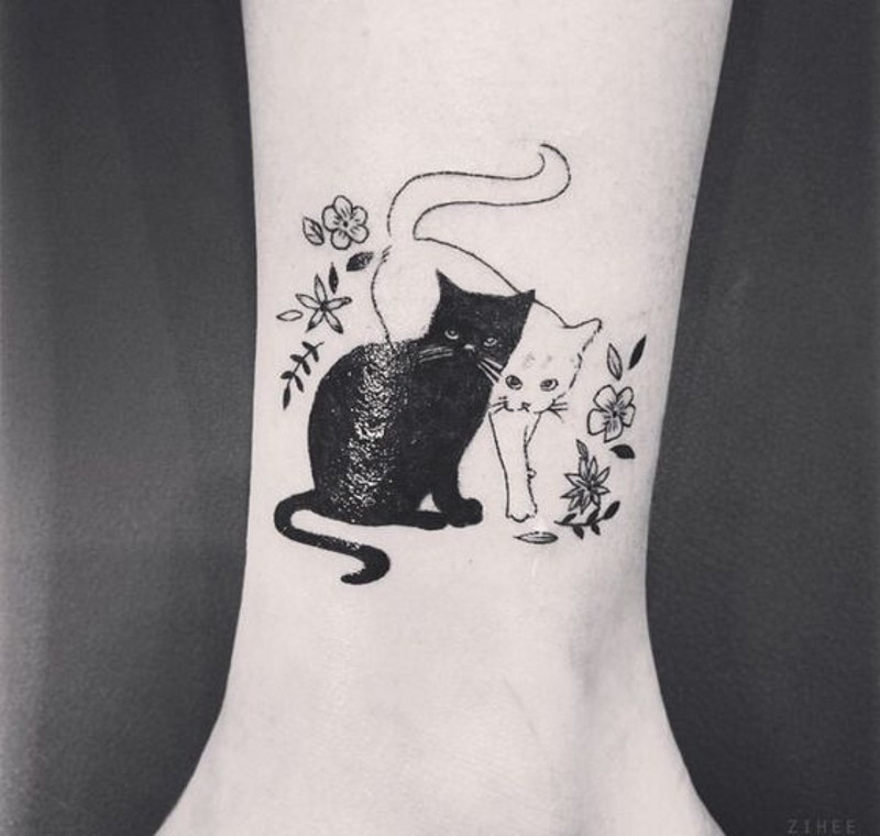 Cute little colored black and white cats with flowers tattoo on ankle