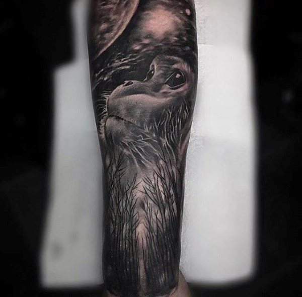 Cute looking black and white monkey and forest tattoo on forearm
