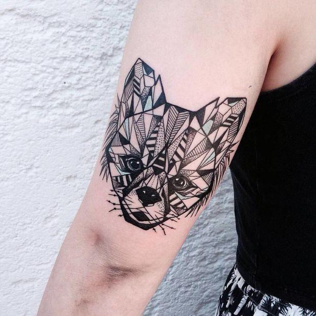 Cute looking black ink arm tattoo of sweet fox head
