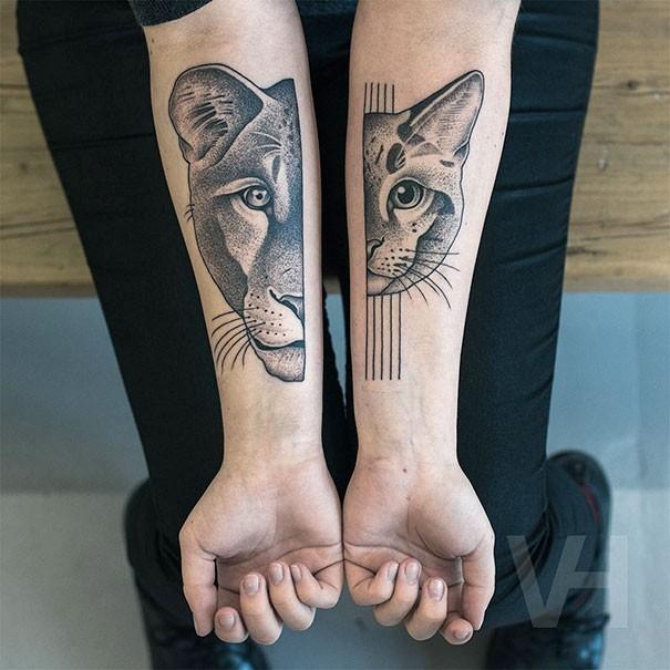 Cute looking black ink Valentin Hirsch tattoo of big lion and cat head