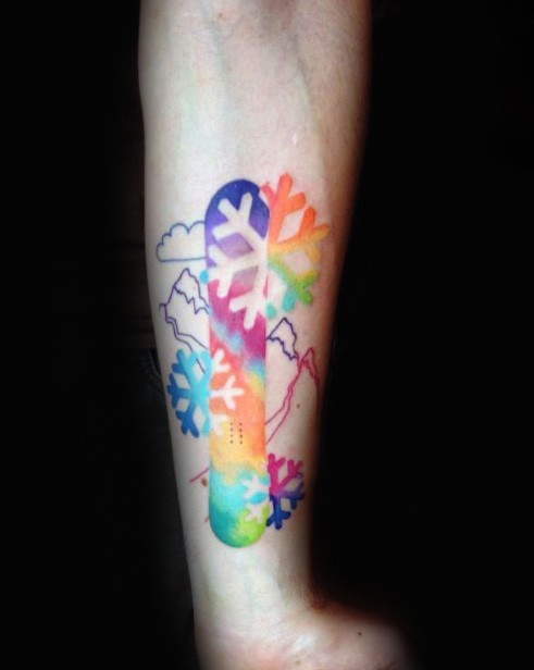 Cute looking colored forearm tattoo of snowboard with snowflake