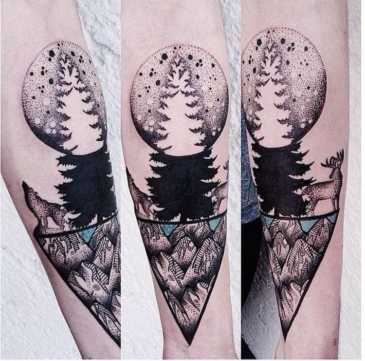 Cute looking colored forearm tattoo of big moon with tree and forest animals