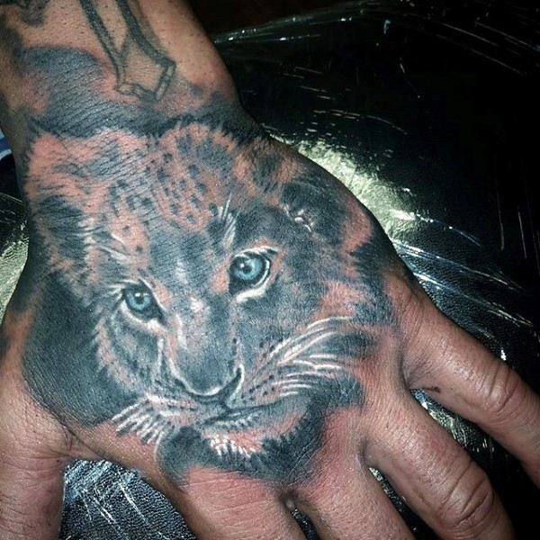 Cute looking colored hand tattoo of sweet little lion face
