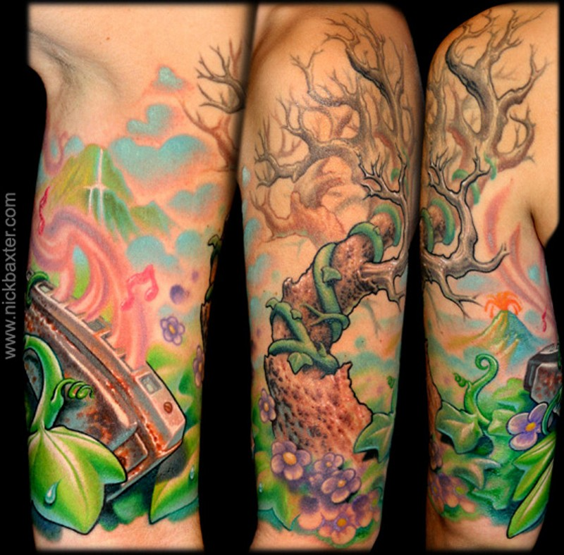 Cute looking colored shoulder tattoo of lonely tree and nice harmonic