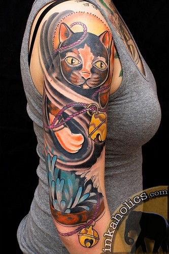 Cute looking colored shoulder tattoo of impressive cat with flowers