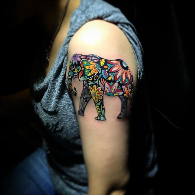 Cute looking colored shoulder tattoo of big beautiful elephant