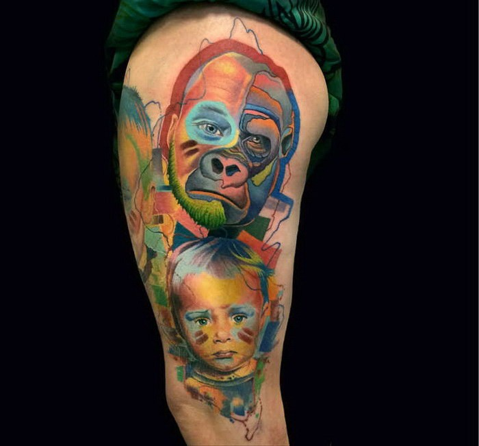 Cute looking colored thigh tattoo of monkey with little boy