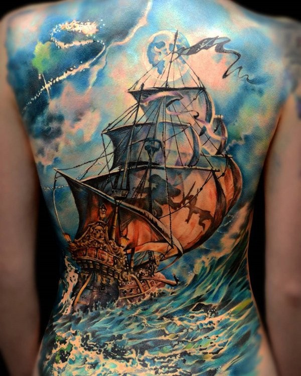 Cute looking colored whole back tattoo of large sailing ship with bi waves