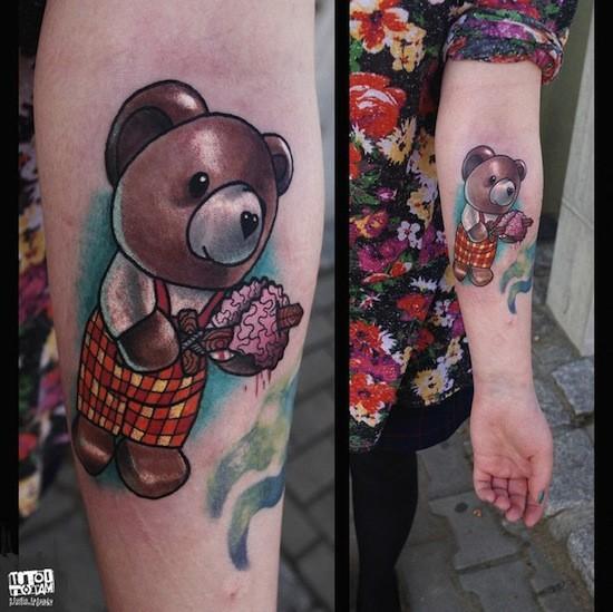 Cute medium size colored forearm tattoo of little bear