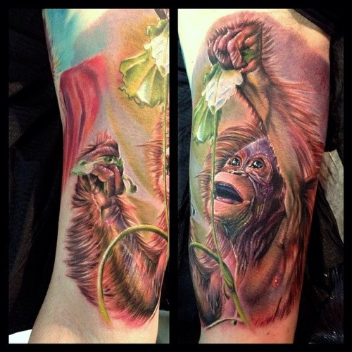 Cute natural painted very detailed colored monkey with flower tattoo on arm