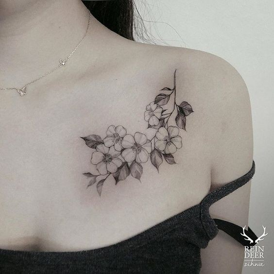 Cute nice looking chest tattoo of beautiful flowers by Zihwa
