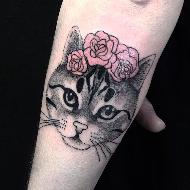 Cute painted and colored forearm tattoo of cat head with pink flowers