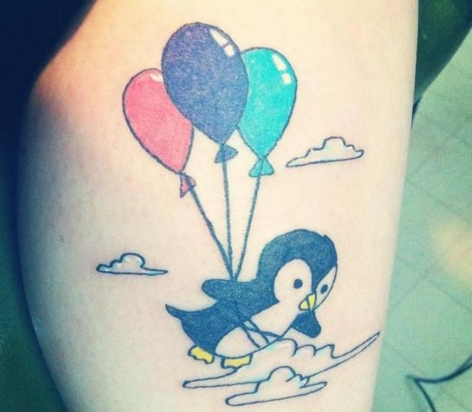 Cute penguin flying with color balloons tattoo
