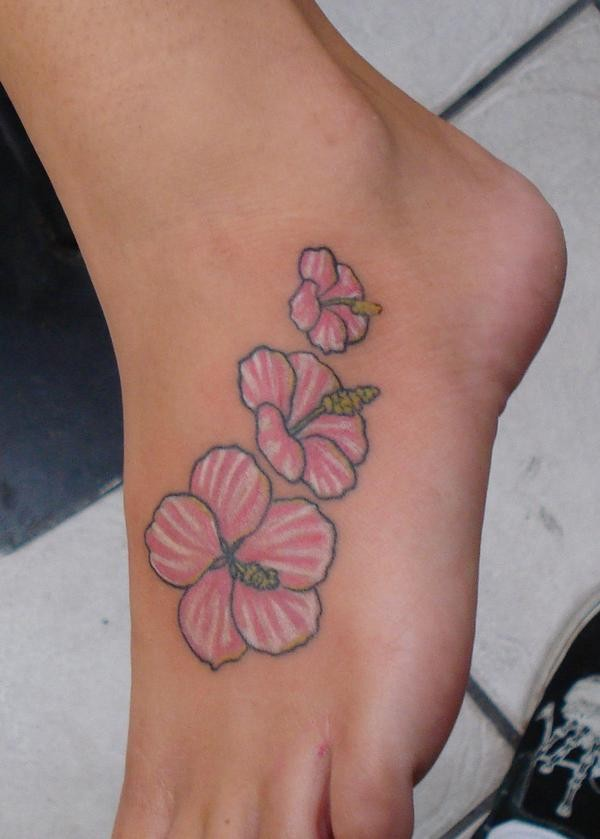 Cute pink and white tattoo on foot