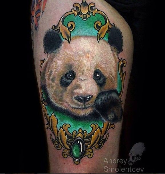 Cute realism style colored thigh tattoo of panda bear head