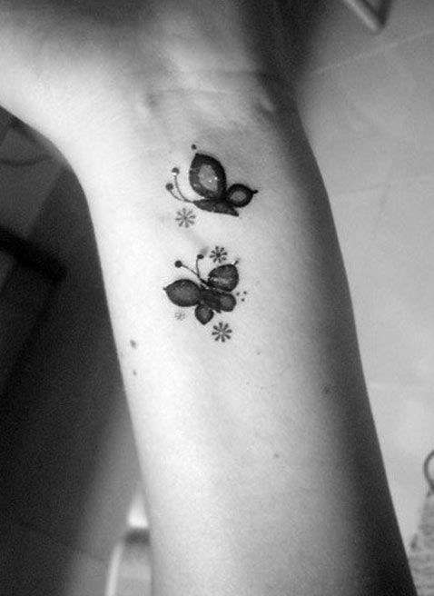 Cute small butterfly tattoo with stars