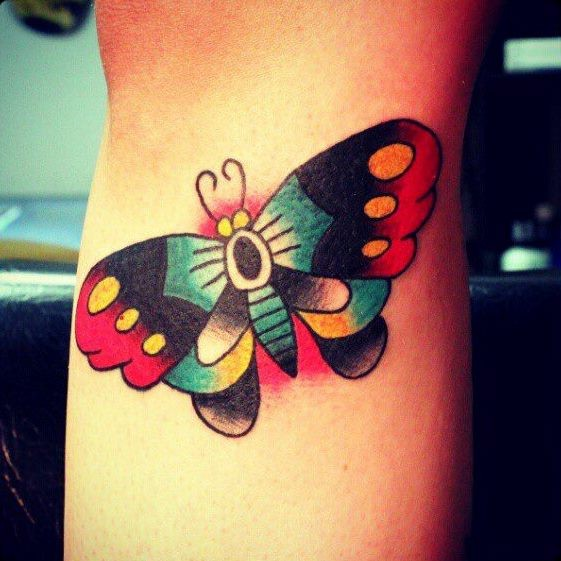 Cute traditional butterfly tattoo for male