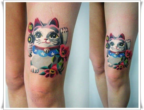 Cute watercolor cat tattoo on thigh by Sasha