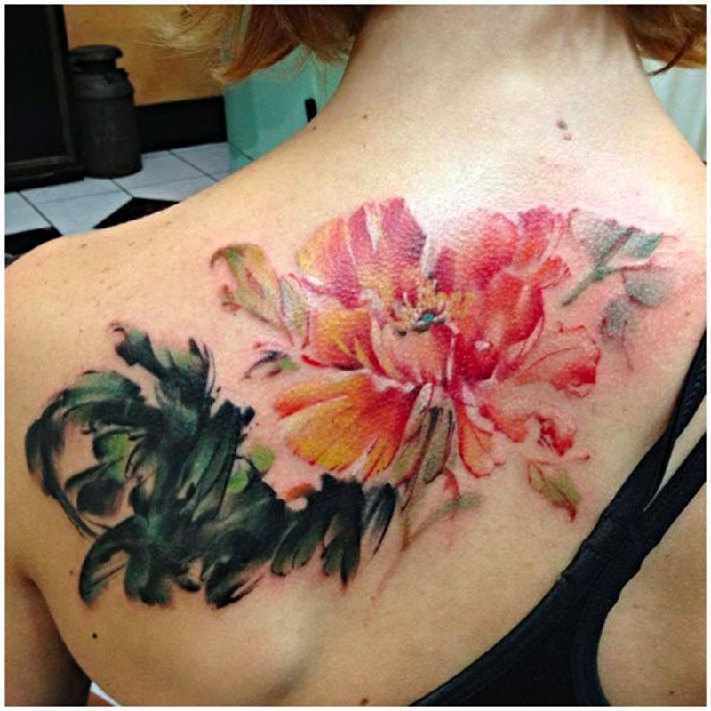 Cute watercolor painted big flower tattoo on upper back