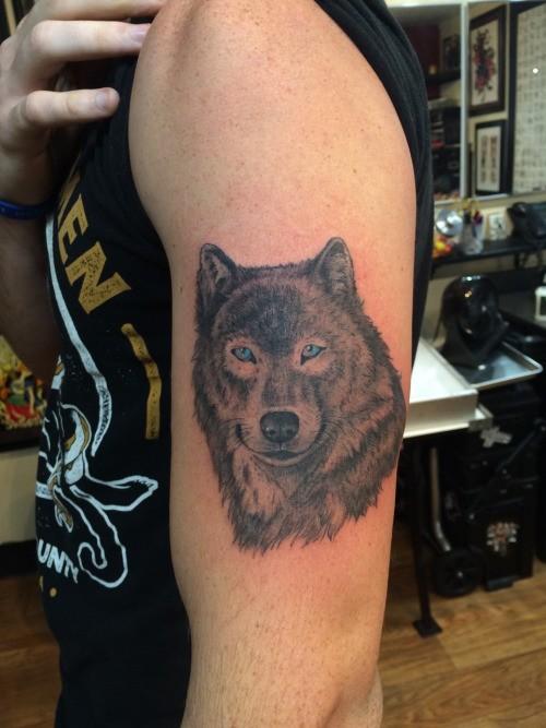 Cute wolf face tattoo design idea