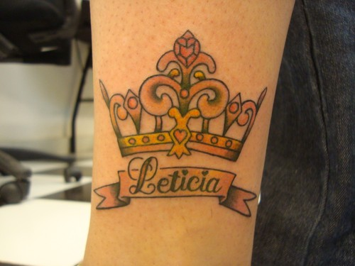 Cute tattoo yellow crown with script