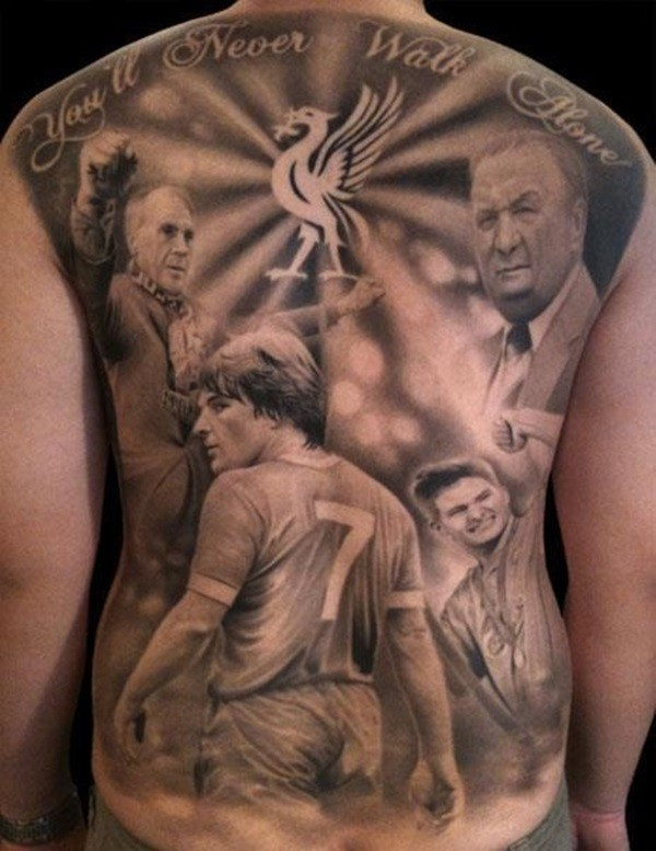 Dark black and gray style whole back tattoo of football players with manege and lettering