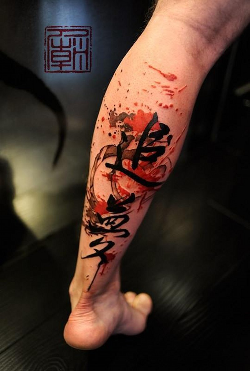 Dark black ink Asian hieroglyphs tattoo on calf with colored paint drips