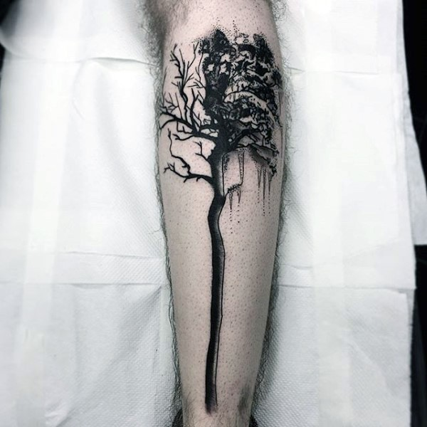 Dark black ink leg tattoo of big tree and sun