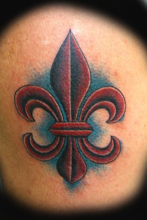 Dark burgundy fleur de lis tattoo