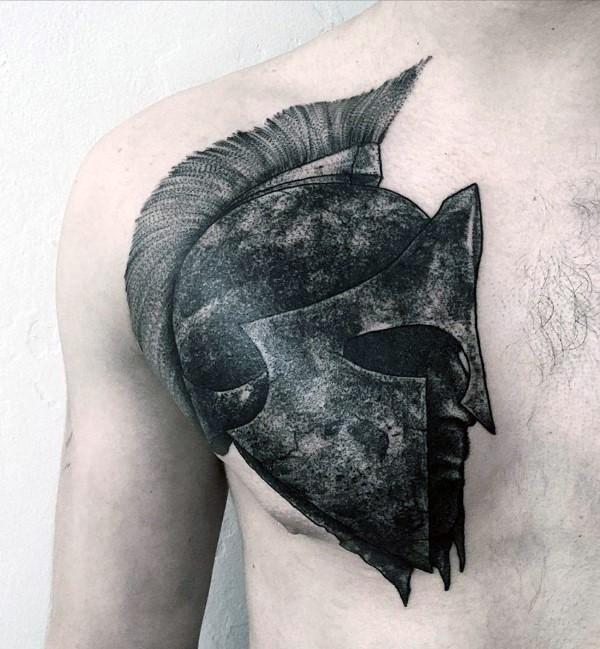 Dark colored Spartan warrior&quots head in helmet detailed chest tattoo