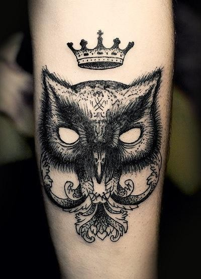 Dark owl and crown tattoo