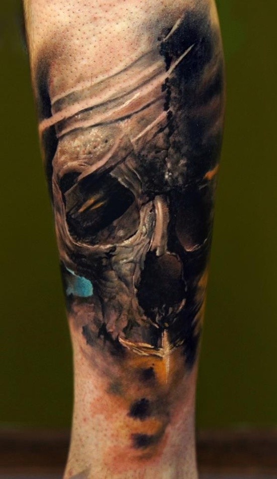 Dark broken human skull tattoo