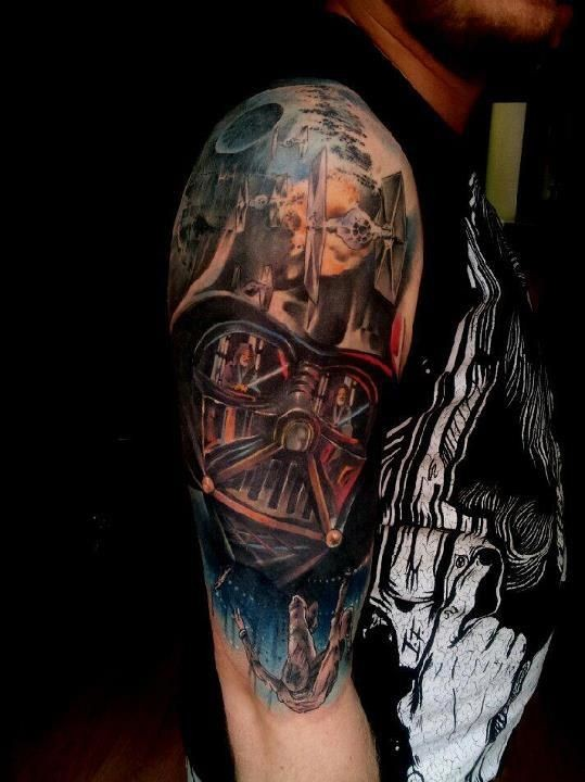 """Darth Vader""""s helm and Star Wars scenery colored detailed original upper arm tattoo"""