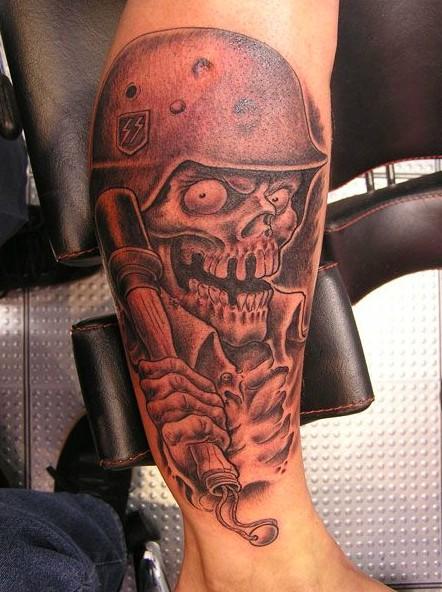 Death in a military helmet tattoo on leg